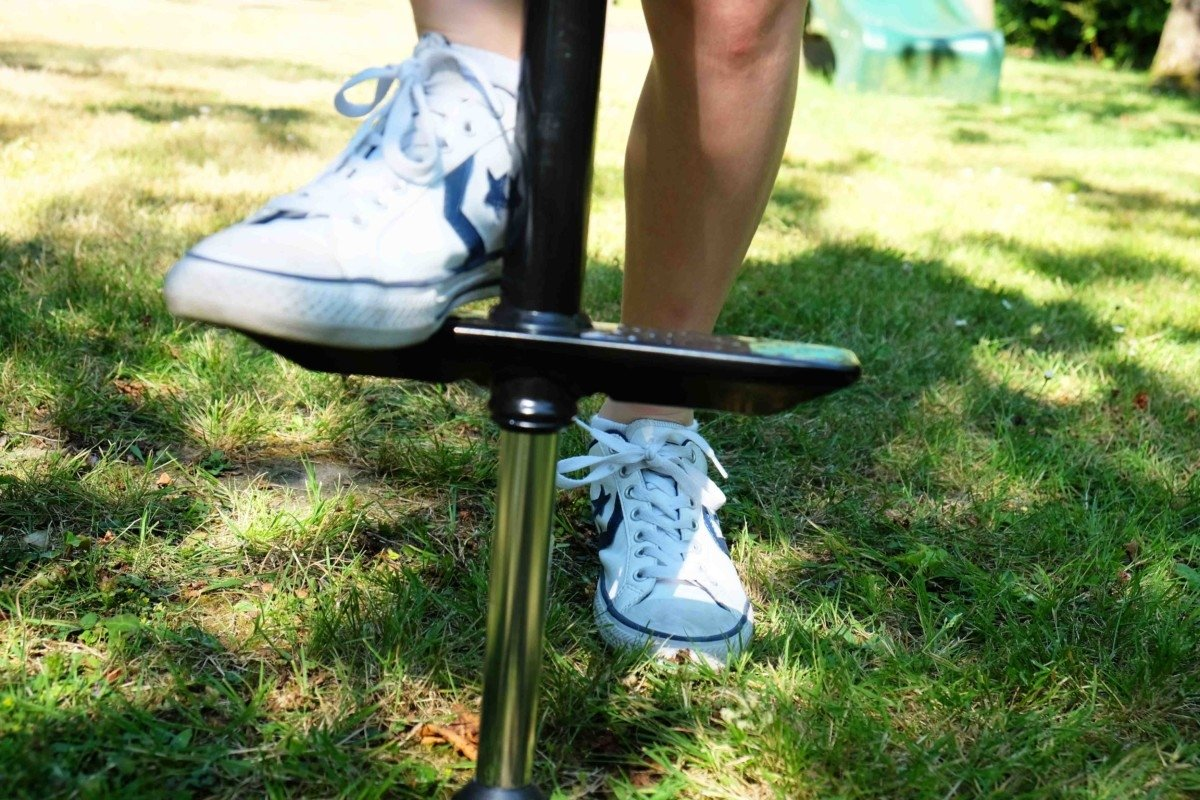 child on pogo stick Top 10 Tips to encourage your child to play outside