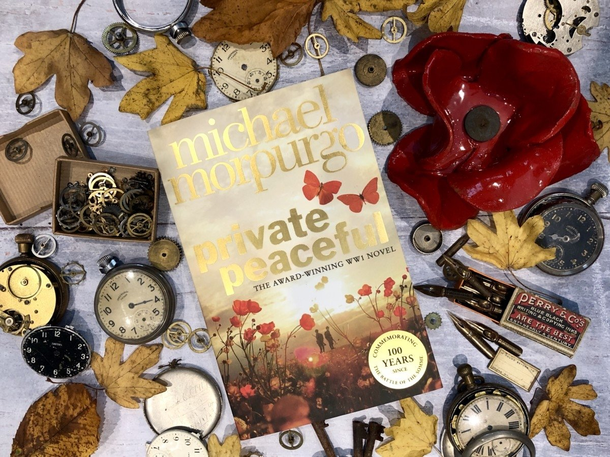 Michael Morpurgo Private Peaceful Unsung Heroes Book Tour flat lay of the book and poppies