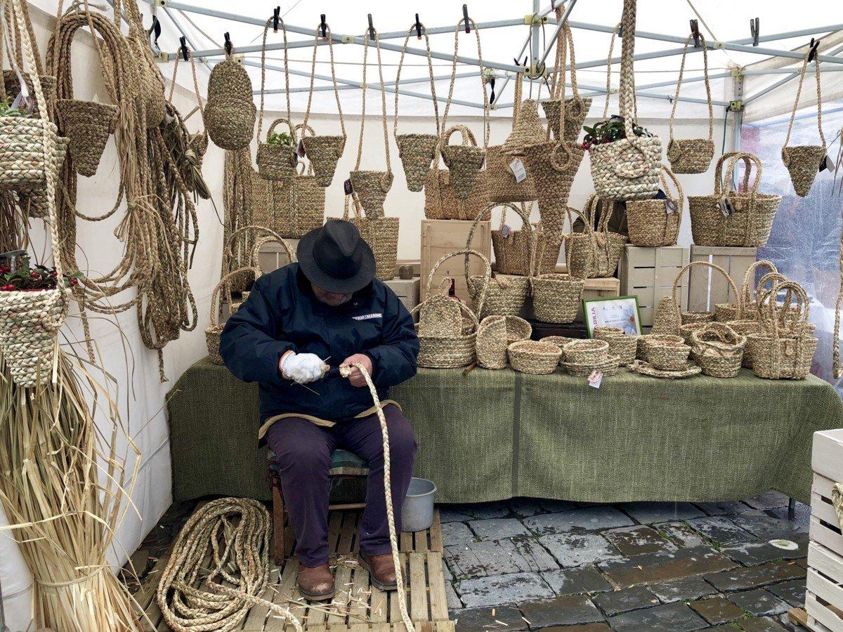 Basilica di santo Spirito straw weaving stall in the market