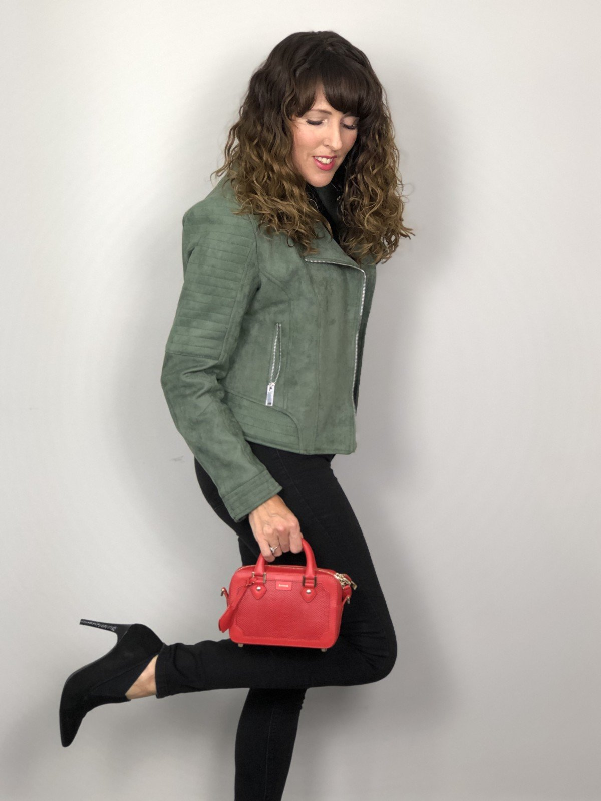 Classic Faux suede biker and black jeans and roll neck add a splash of colour