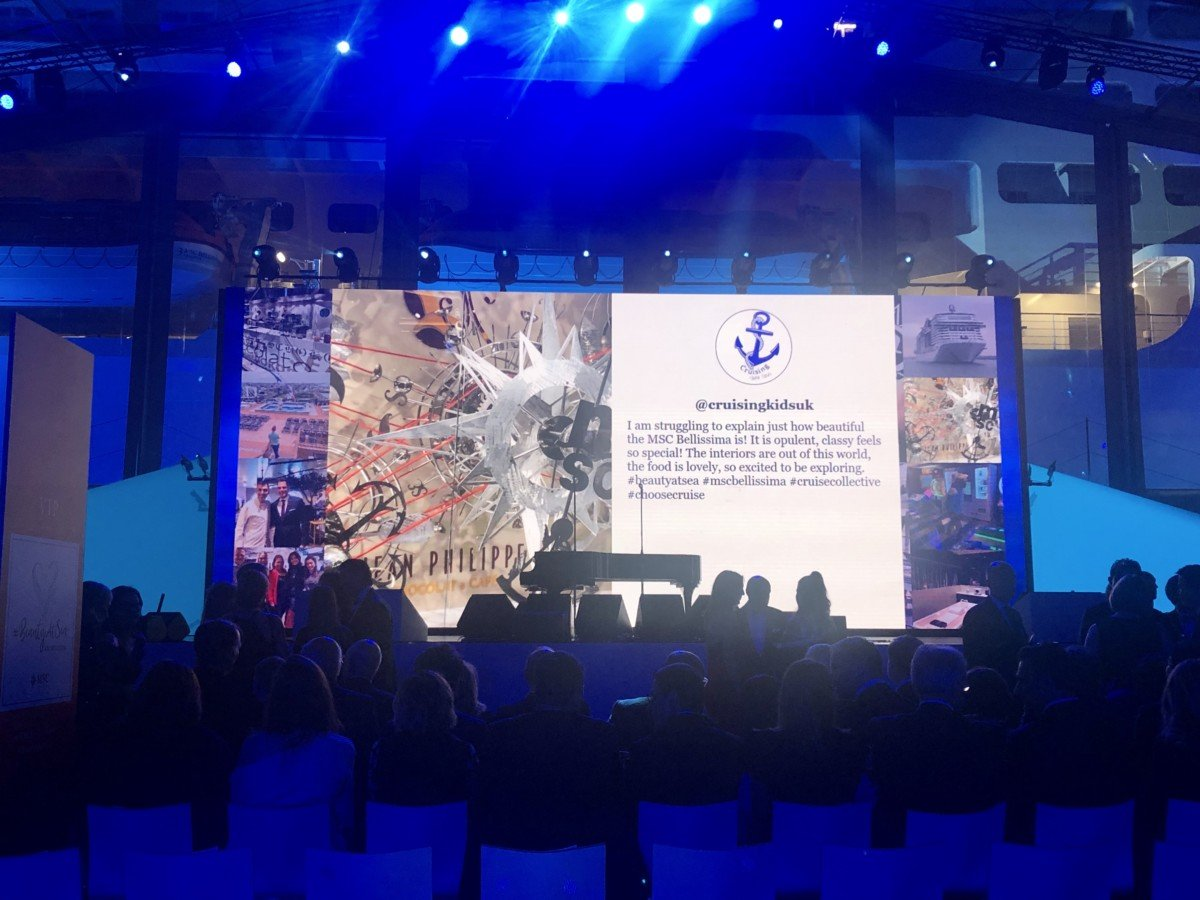 MSC Bellissima naming celebration showing Cruising with kids on the main stage screen