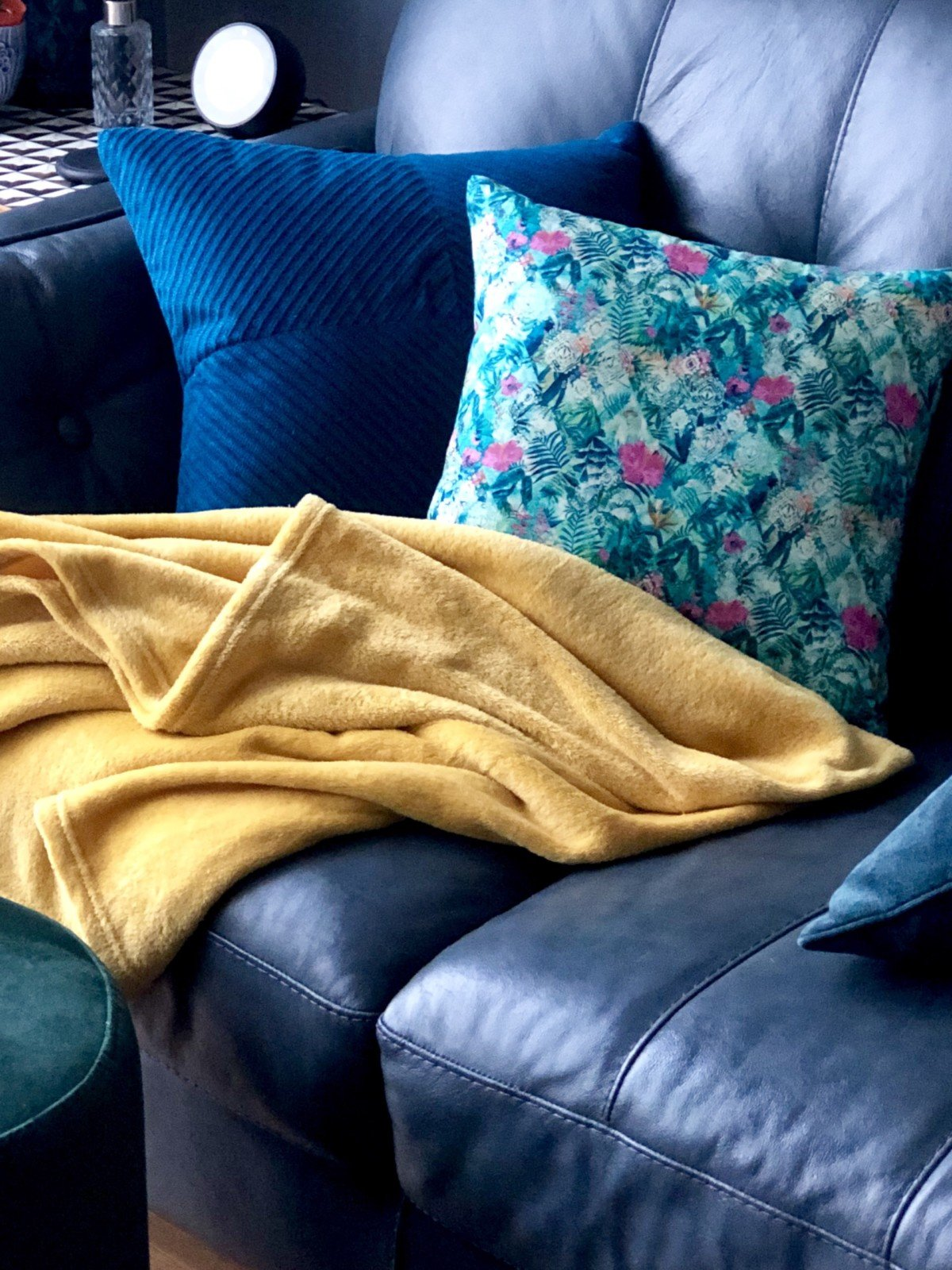 Homemade sewed tropical cushion on Sofa. After saucing my fabric at the log cabin in Billericay I had two pieces of fabric ready to make some classy cushions for the home.