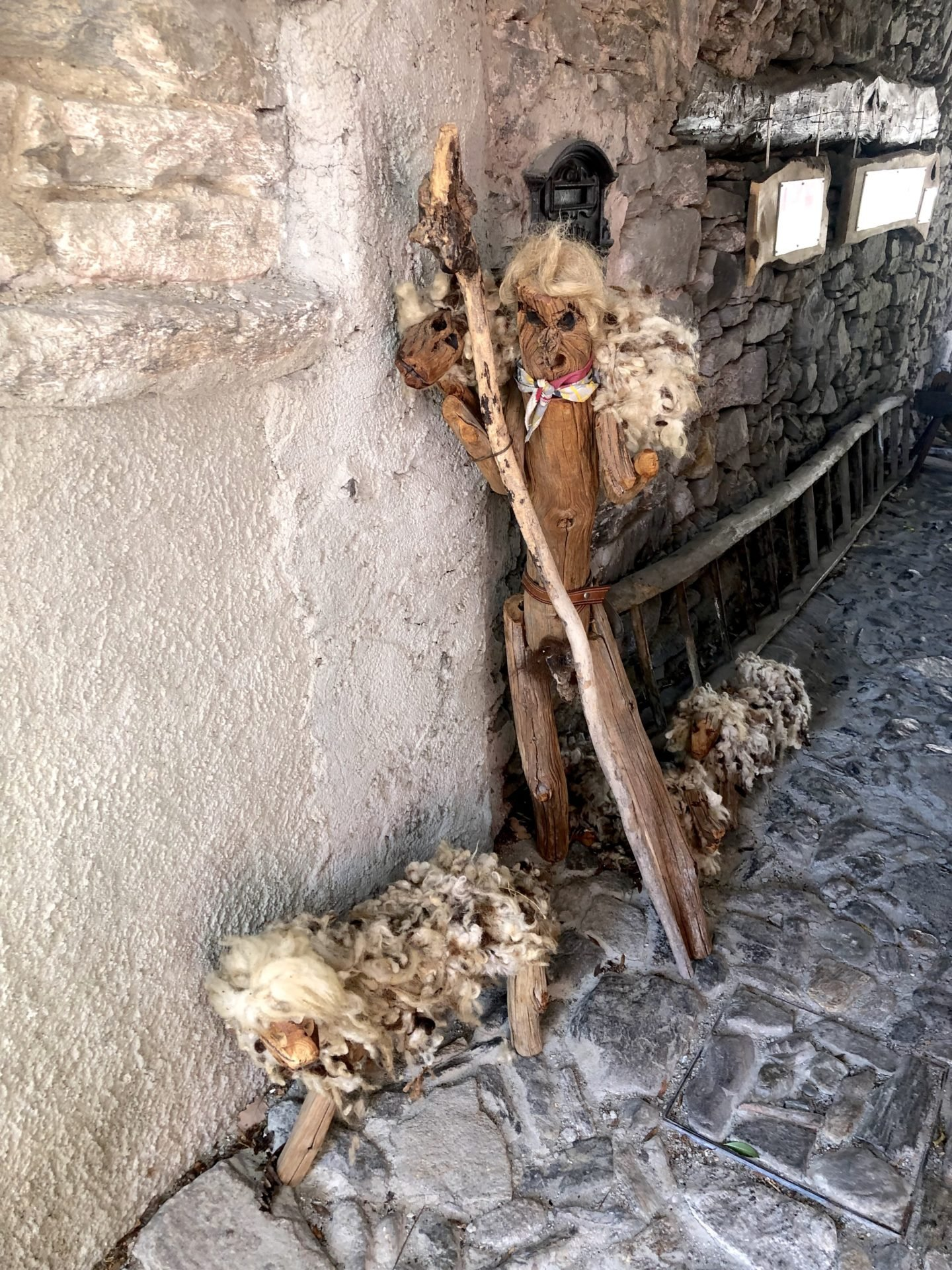 A shepard and sheep made out of wood in the town of Musignano, Lake Maggiore