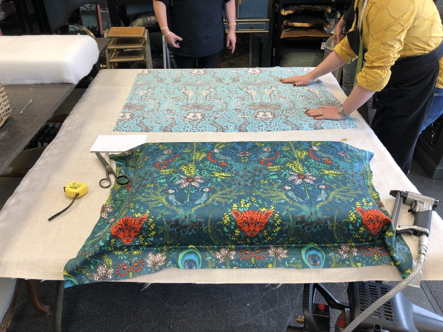 Making an upholstered footstool in Essex. the footstool is bang on trend and chic for todays interior. With Fabric from Emma Shipley.
