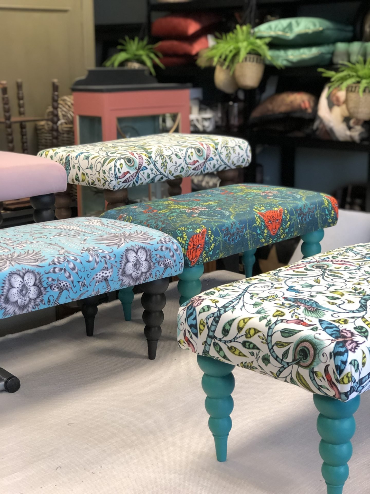 A range of Upholstered footstools with Emma Shipley fabric and Annie Sloan chalk paint