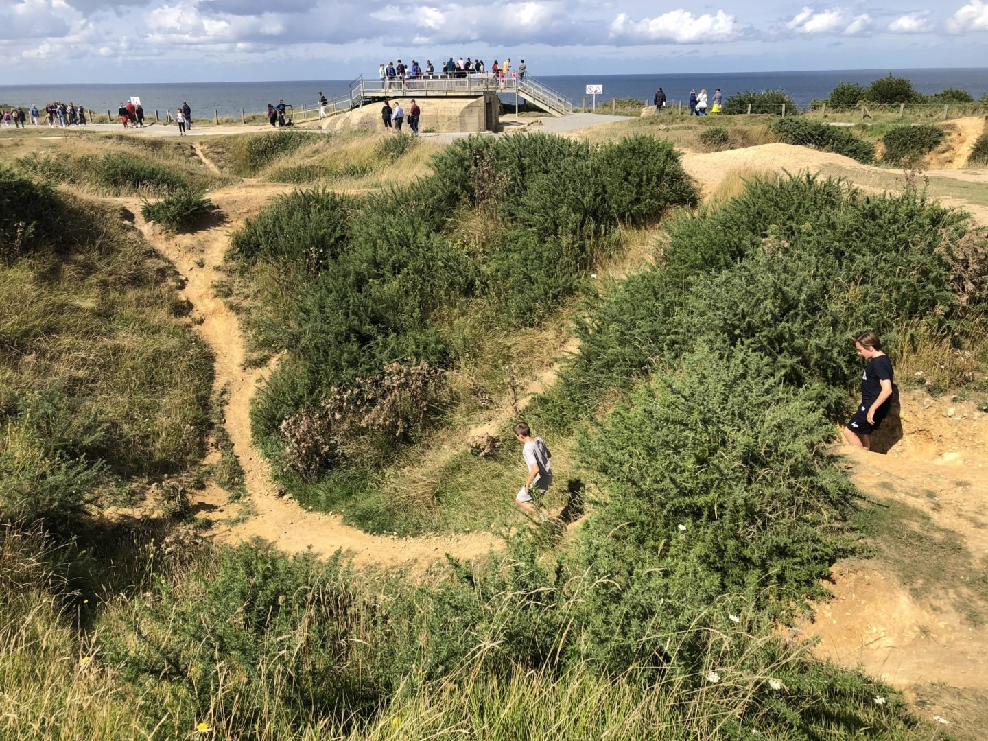 One Day Itinerary for the D day Normandy Beaches with Kids. Pointe du Hoc Bomb craters