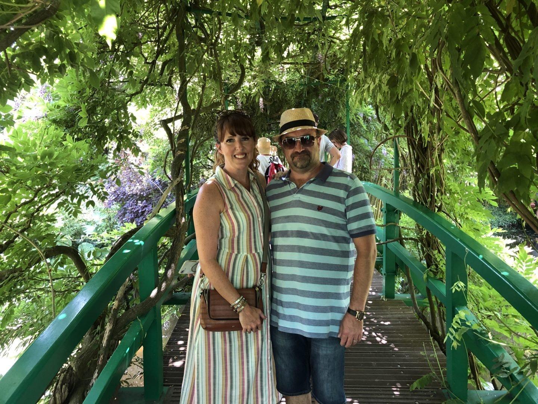 Claude Monet's Water lily bridge tourists love a photo on the bridge.