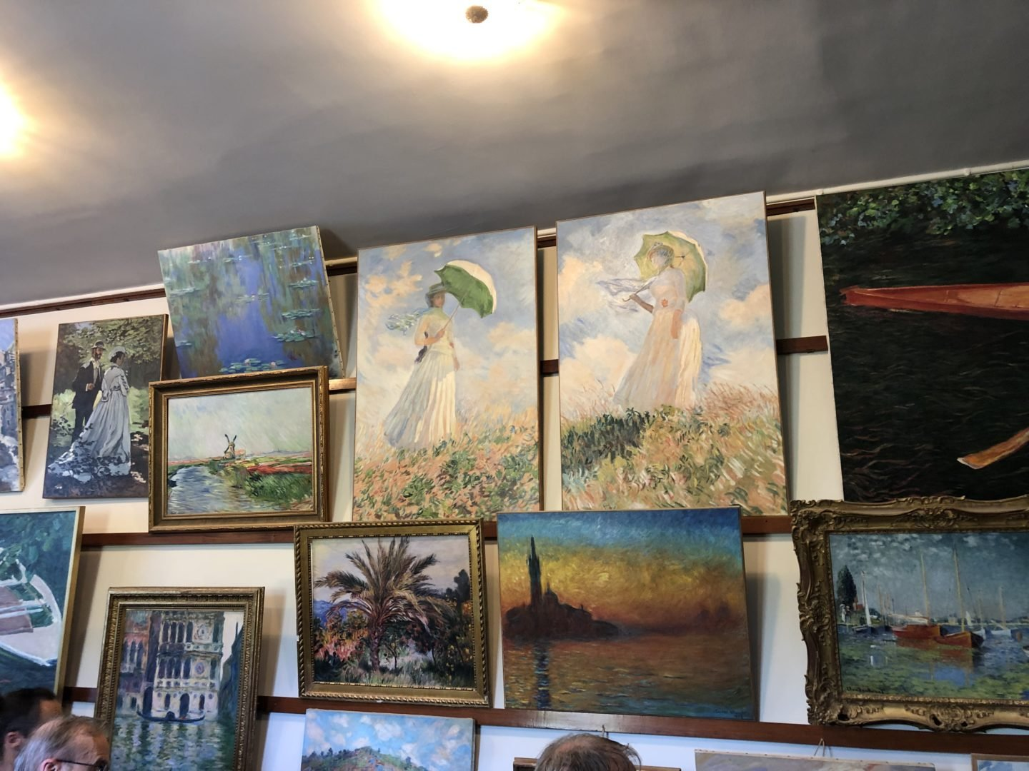 Monets studio Giverny, Are the paintings in Monets House real or copies? Although Monets collection of prints and ornaments are still on display the much rarer paintings in museums and the paintings you see today are copies of the originals.