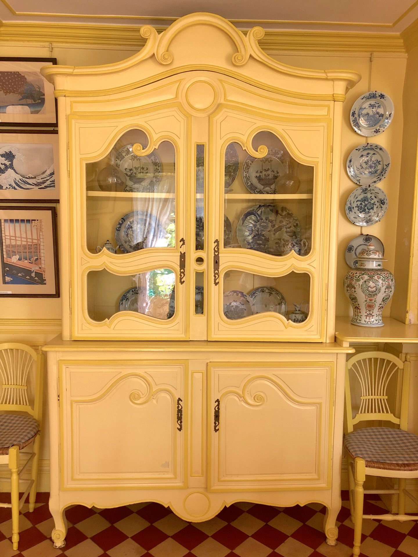 Monet's yellow dining room, The yellow french dresser looks like the armoire from Disneys Beauty and the Beast.