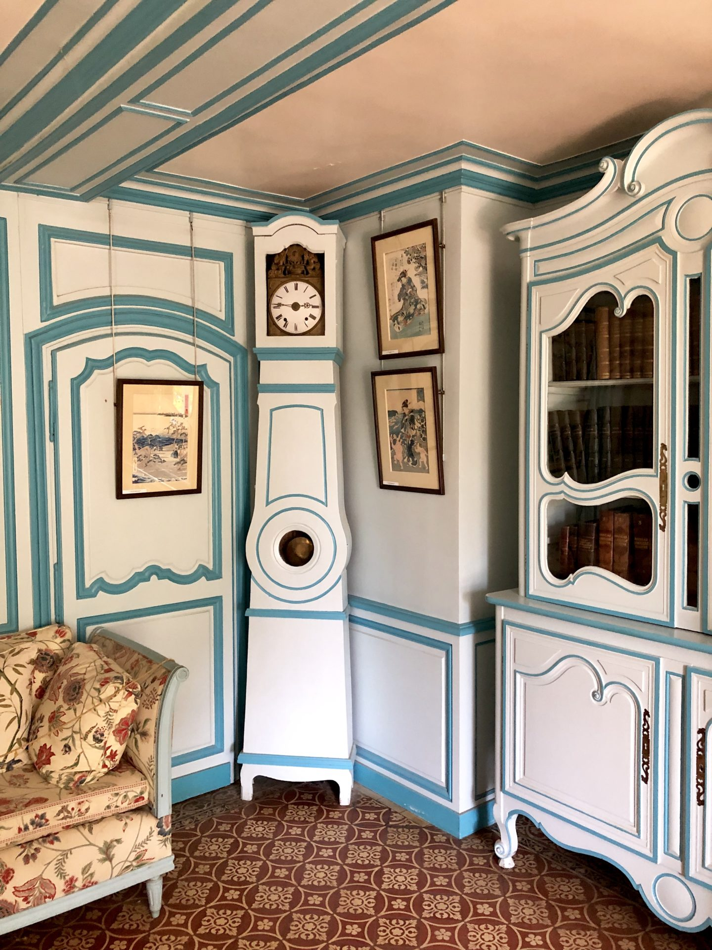 The Blue painted Grandfather clock and furniture in the little blue sitting room in Claude Monets house