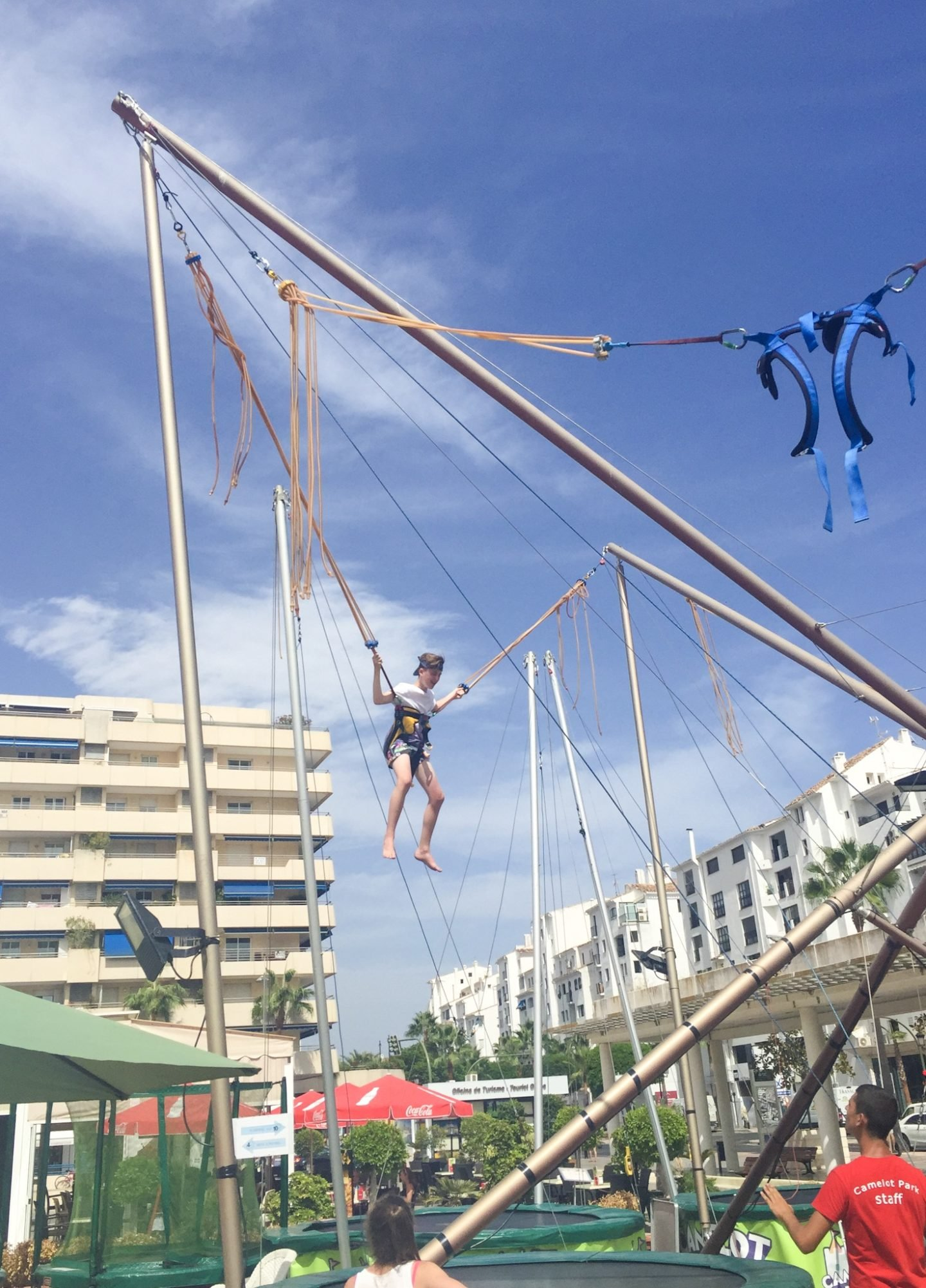 Puerto Banus, Zoco del Sol market in Plaza Antonio Banderas trampolines for kids