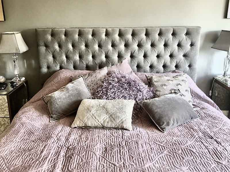 grey and lilac theme bedroom and velour headboard interior design